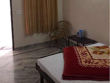 Jeevmoksha Yoga Gurukul Shared Room
