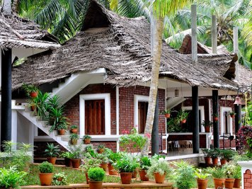 ShinShiva Ayurvedic Ashram Psoriasis Treatment Program Kerala Wooden Bungalow