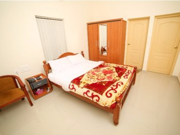 Sree Chithra Ayur Home - Indian Residents Spine & Neck Care Program Signature Cottages